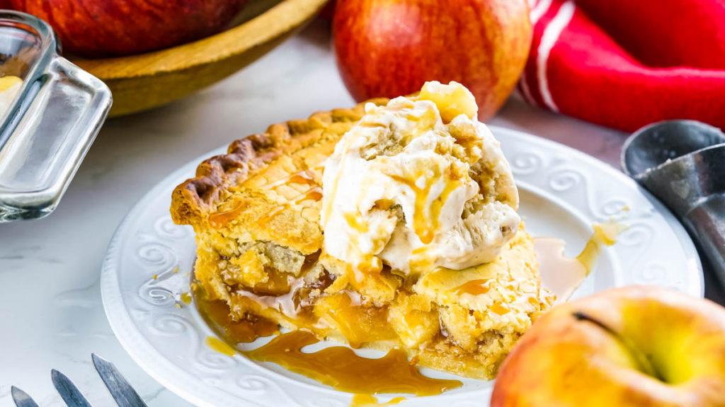 slice of apple pie with scoop of apple pie ice cream on top