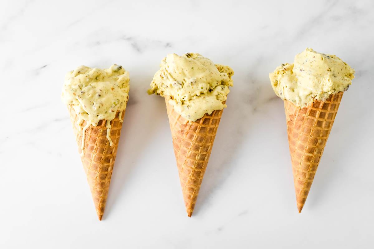 three waffle cones with pistachio ice cream